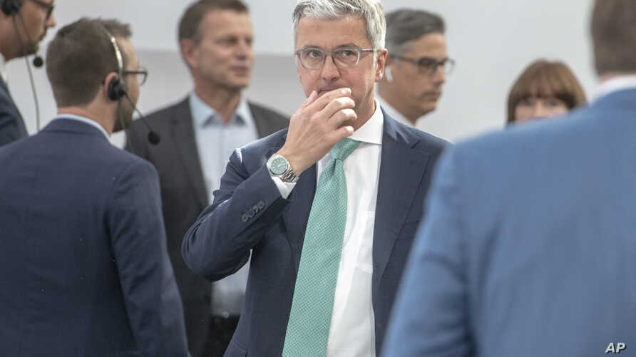 FILE - Audi CEO Rupert Stadler arrives for the annual shareholders meeting in Ingolstadt, May 9, 2018. (Armin Weigel/dpa via AP)