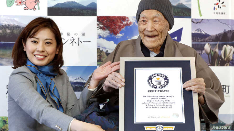 Japanese Masazo Nonaka, who was born 112 years and 259 days ago, receives a Guinness World Records certificate naming him the world's oldest man during a ceremony in Ashoro, on Japan's northern island of Hokkaido, April 10, 2018.