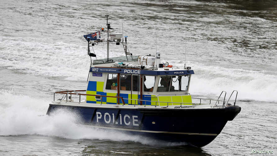 A police launch travels along the Thames near London Bridge after it was reopened following an attack which left 7 people dead and dozens of injured in central London, Britain, June 5, 2017.