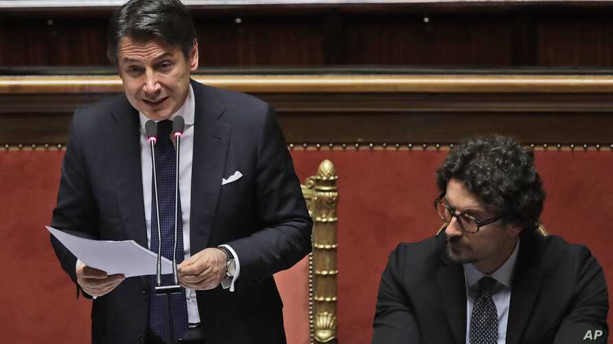 Italian Premier Giuseppe Conte, flanked by Infrastructures and Transport Minister Toninelli, addresses the Italian Senate, March 19, 2019. Conte has pledged to make Italy the first G7 nation to join China's ambitious Belt and Road Initiative.