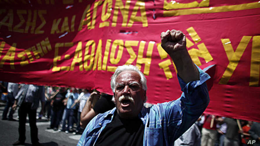 A protester shouts slogans during a May Day protest in Athens, May 1, 2012.