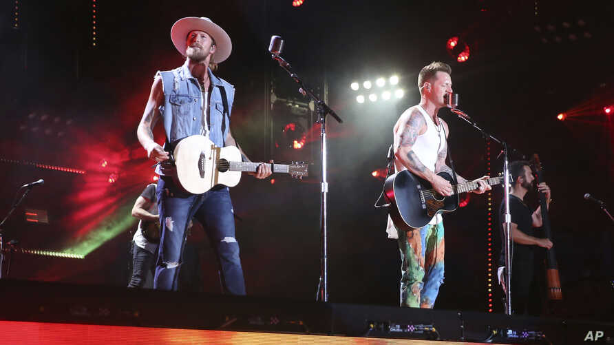 Brian Kelley, left, and Tyler Hubbard of Florida Georgia Line perform at the 2018 CMA Music Festival in Nashville, Tennessee, June 10, 2018.