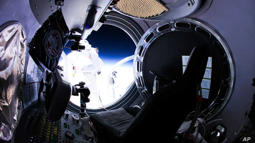 This photo provided by Red Bull Stratos shows pilot Felix Baumgartner of Austria as he jumps out of the capsule during the final manned flight for Red Bull Stratos on Sunday, Oct. 14, 2012. In a giant leap from more than 24 miles up, Baumgartner shat