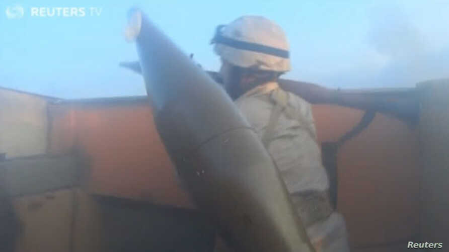Screen grab from Reuters video of footage from IS fighter's helmet-camera.