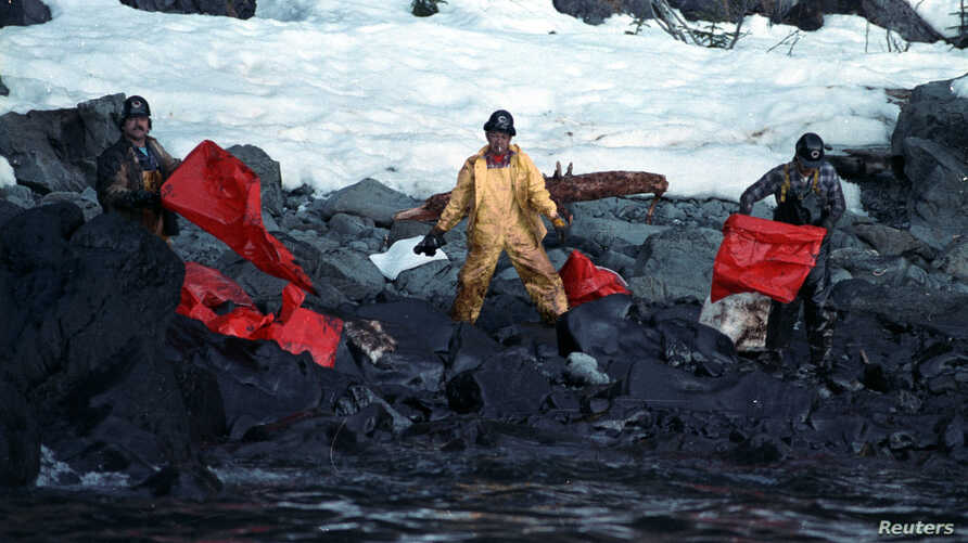 Crews clean up the oil-soaked beach on Naked Island in the Prince William Sound, on April 2, 1989, after the worst oil spill in U.S. history, cased by the Exxon tanker Valdez.