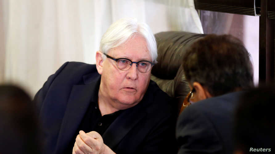 FILE - U.N. envoy to Yemen Martin Griffiths listens to the undersecretary of Houthi-led government's foreign ministry, Faisal Amin Abu-Rass upon his arrival at Sanaa airport in Sanaa, Yemen, June 16, 2018.