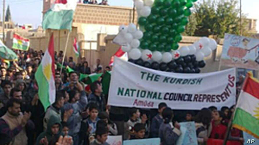 Demonstrators protesting against Syria's President Bashar al-Assad march through the streets on the first day of the Muslim festival of Eid-al-Adha in Alsnmin near Daraa, November 6, 2011.