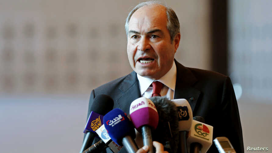 FILE - Jordan's Prime Minister Hani Mulki speaks to the media after the swearing-in ceremony for the new cabinet at the Royal Palace in Amman, Jordan, June 1, 2016.