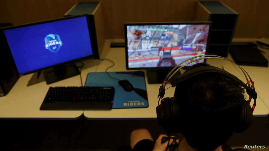 """A member of the Movistar Riders esports team trains on the """"Call of Duty"""" video game at Movistar ESports Center in Madrid, Spain, May 31, 2017."""
