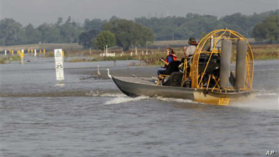 U.S. Army Corps of Engineers personnel in an airboat in the Bonnet Carre Spillway, as workers remove some of the Bonnet Carre Spillway's wooden barriers, which serve as a dam against the high water in Norco, La., May 9, 2011
