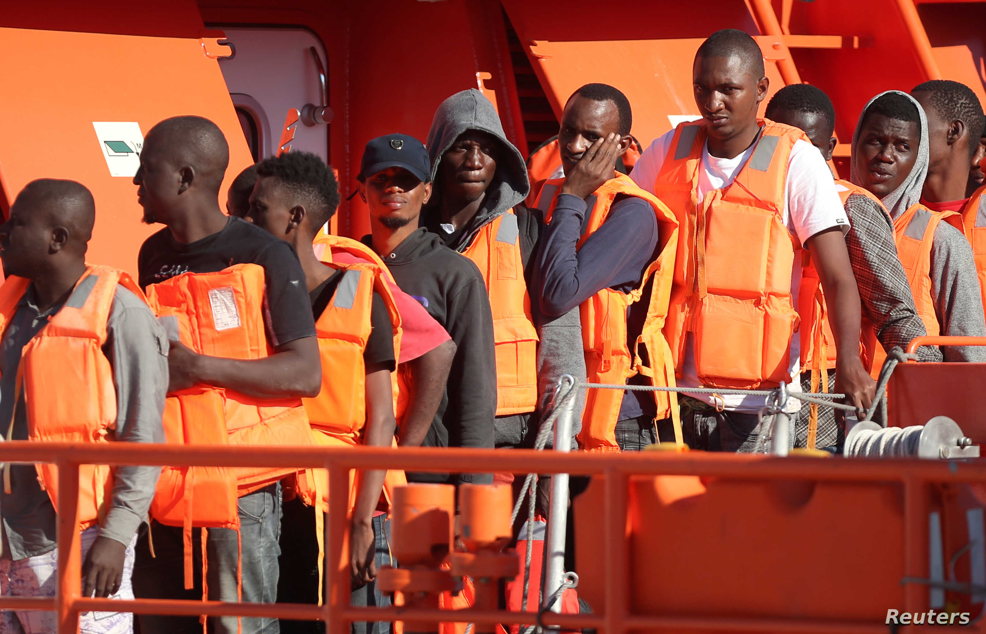FILE - Migrants are seen on a rescue boat at the port of Malaga, southern Spain, Sept. 23, 2018.