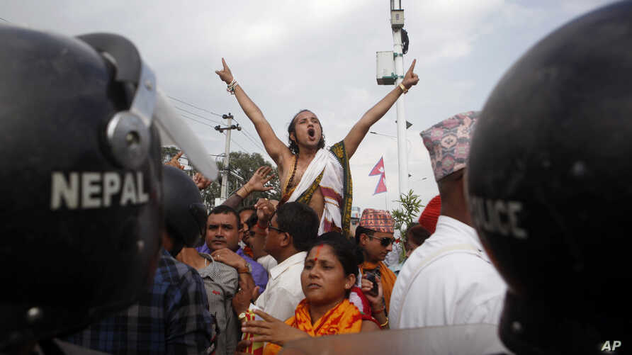 A Nepalese Hindu activist shouts slogans at a rally near the Nepalese Constituent Assembly Hall during a protest in Kathmandu, Nepal, Sept. 1, 2015.