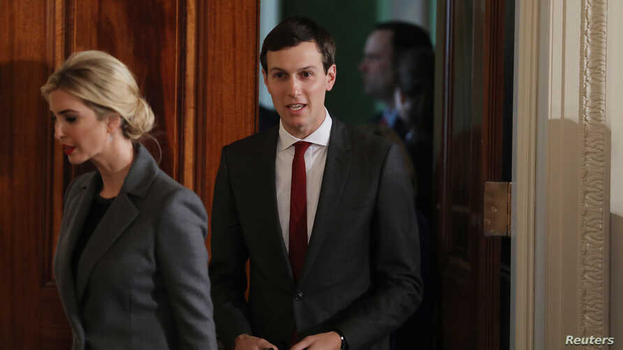 White House senior advisor Jared Kushner enters the East Room with his wife Ivanka Trump, prior to a joint news conference between President Donald Trump and Israeli Prime Minister Benjamin Netanyahu, at the White House in Washington, Feb. 15, 2017.