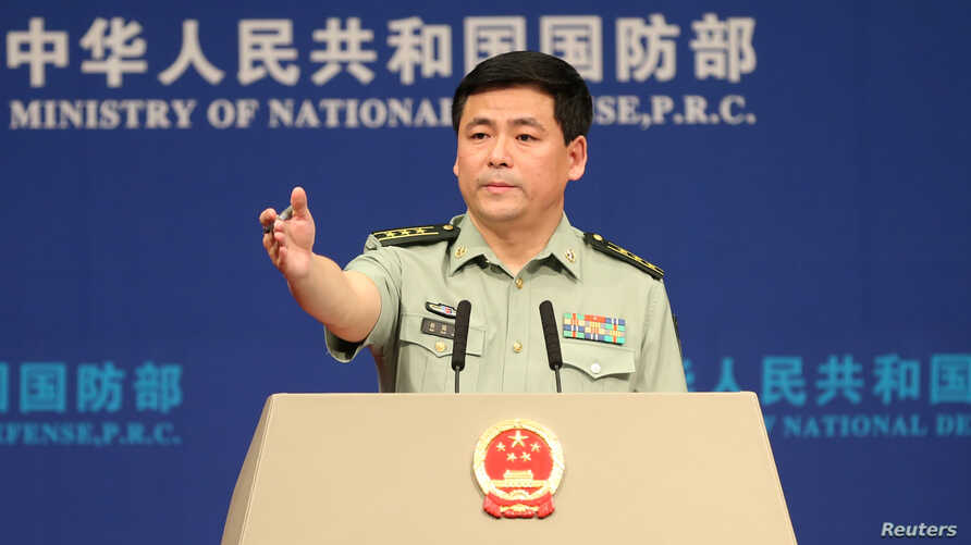 Chinese Defense Ministry spokesman Ren Guoqiang attends a news briefing in Beijing, China, May 25, 2017. Ren reiterated Thursday that China strictly enforced U.N. resolutions on North Korea.