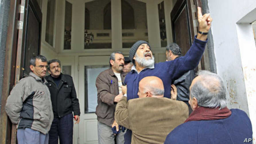 An anti-government protester chants slogans in front of the foreign media in Homs, Syria, January 23, 2012.