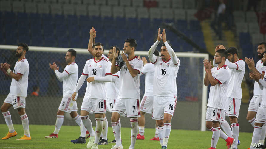Iran's players acknowledge their supporters following a friendly soccer match between Turkey and Iran, in Istanbul, May 28, 2018. U.S. U.S. sports apparel company Nike says it cannot provide shoes for the Iranian team because of the Trump administrat