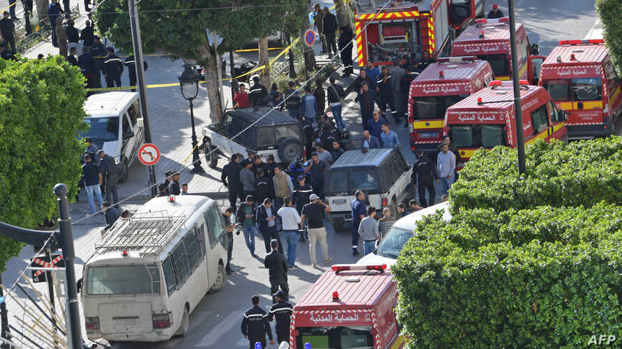 A picture taken on October 29, 2018, shows police and firemen gathering at the site of a suicide attack in the centre of the Tunisian capital Tunis.