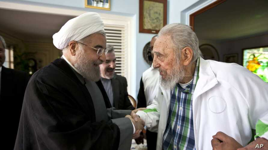 Cuba's former leader Fidel Castro, right, shakes hands with Iranian President Hassan Rouhani in Havana, Cuba, Monday, Sept 19, 2016.
