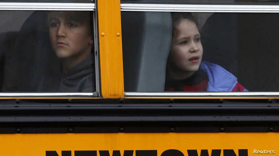 Students ride a school bus in Newtown, Connecticut December 18, 2012.
