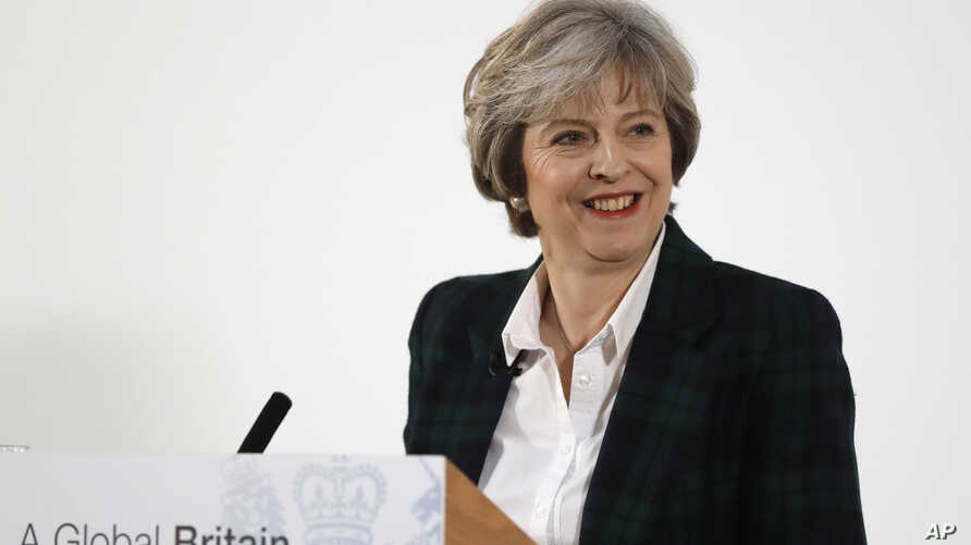 Britain's Prime Minister Theresa May smiles after she delivers a speech on leaving the European Union at Lancaster House in London, Jan. 17, 2017.