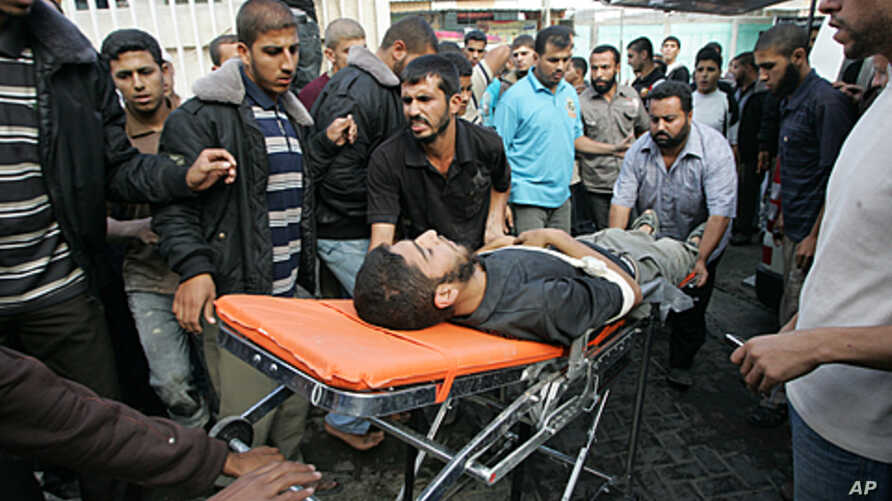 Palestinians wheel into the al-Najar hospital an injured Palestinian militant of Islamic Jihad following an Israeli air strike in the southern Gaza Strip town of Rafah, October 29, 2011.