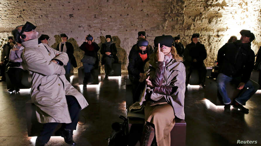 People wear virtual reality devices inside the Domus Aurea, built by Roman Emperor Nero in 64 A.D. and later buried by Emperor Trajan in Rome, Italy, Jan. 31, 2017.
