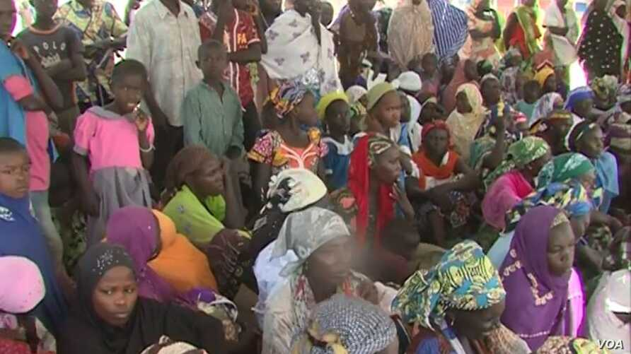 Nigerian women at a meeting with Cameroon authorities, Makary, Cameroon, April 7, 2019. (M. Kindzeka/VOA)