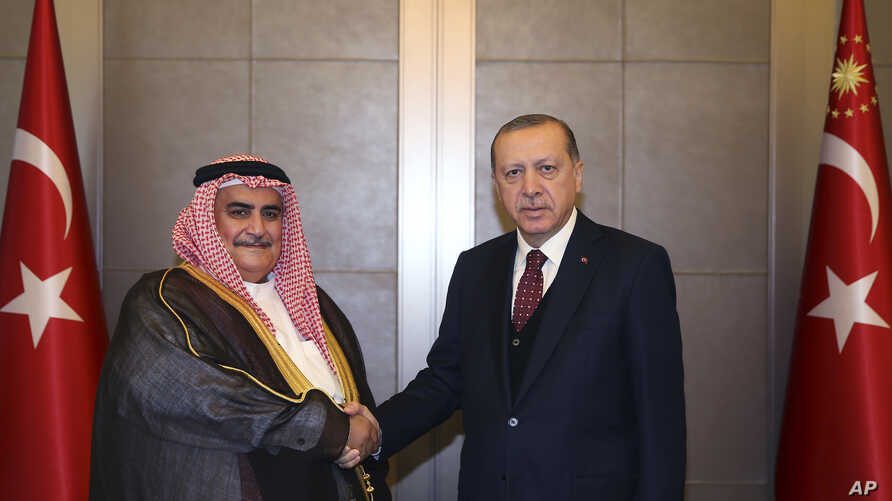 Turkey's President Recep Tayyip Erdogan, right, shakes hands with Bahrain's Foreign Minister Sheik Khalid bin Ahmed Al Khalifa prior to their meeting in Istanbul, June 10, 2017.