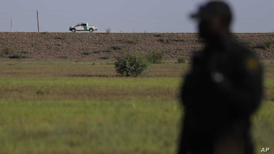 In this Aug. 11, 2017, photo, U.S. a Customs and Border Patrol vehicle patrols along a levee in Granjeno, Texas. Law enforcement officials in the Rio Grande Valley say a border wall is part of their strategy to slow the entry of drugs and illegal imm