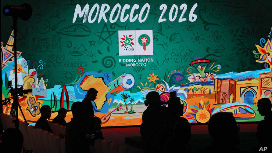 FILE - In this March 17, 2018 file photo, a giant screen displays the logo of Morocco 2026 before a press conference to promote Morocco's bid for the 2026 soccer World Cup in Casablanca, Morocco.