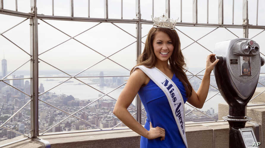 In this Sept. 12, 2017, file photo, newly-crowned Miss America 2018 Cara Mund poses for photographers on the 86th Floor Observation Deck of the Empire State Building, in New York. Mund will be the last Miss America to have worn a swimsuit onstage.