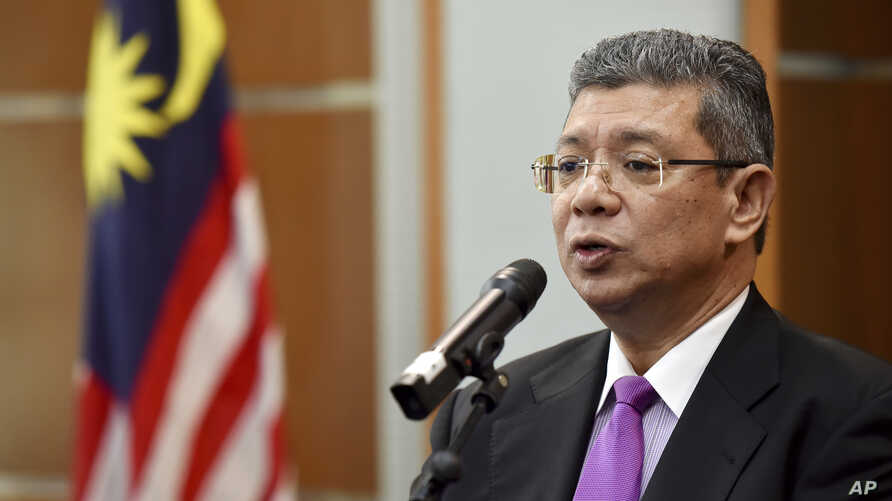 Malaysia Foreign Minister Saifuddin Abdullah speaks during a press conference in Putrajaya, Malaysia, Wednesday, Jan. 16, 2019.