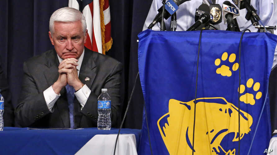 Pennsylvania Governor Tom Corbett waits to speak to a gathering of reporters at the Franklin Regional School District Middle School, April 9, 2014.