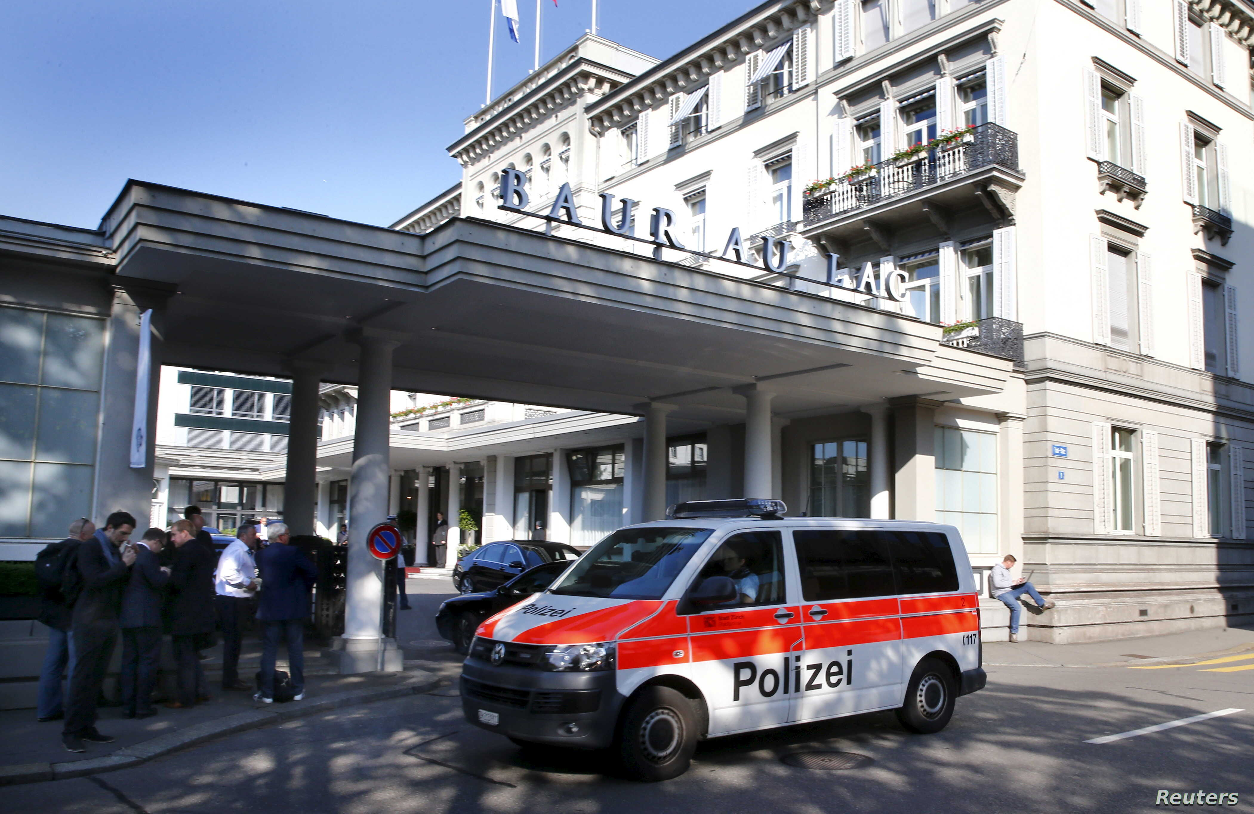 A police van drives past the Baur au Lac hotel in Zurich, Switzerland, May 27, 2015. Six soccer officials were arrested in Zurich on Wednesday and detained pending extradition to the United States over suspected corruption at soccer's governing body