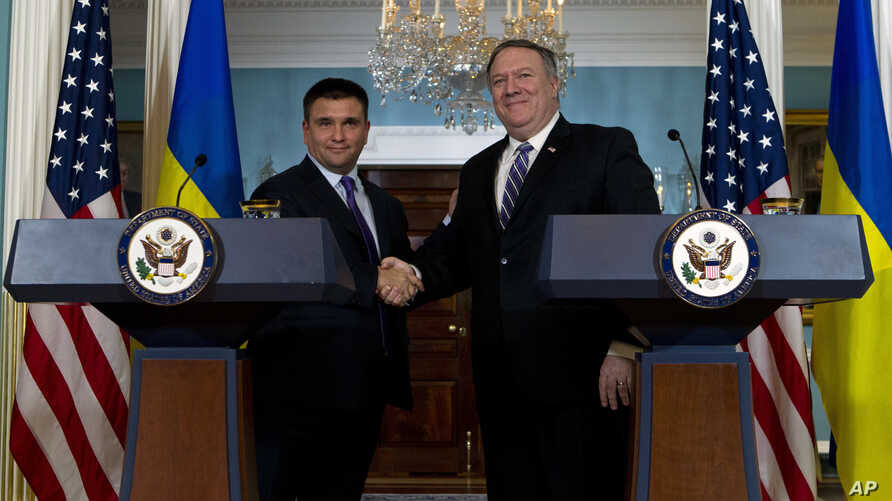 Secretary of State Mike Pompeo shake hands with Ukrainian Foreign Minister Pavlo Klimkin after speaking to the media at the Department of State, Nov. 16, 2018, in Washington.