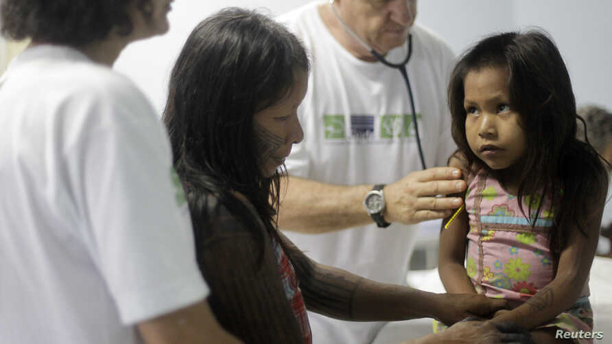 """FILE - A Kayapo girl from Gorotire tribe with symptoms of Malaria fever receives medical attention on the sixth day of a medical expedition of the """"Expedicionarios da Saude"""" (Brazilian Health Expeditions) in Kikretum community in Sao Felix, northern"""