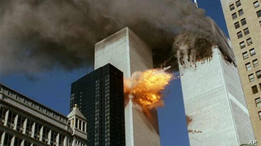 United Airlines Flight 175 collides into the south tower of the World Trade Center in New York as smoke billows from the north tower on September 11, 2001.