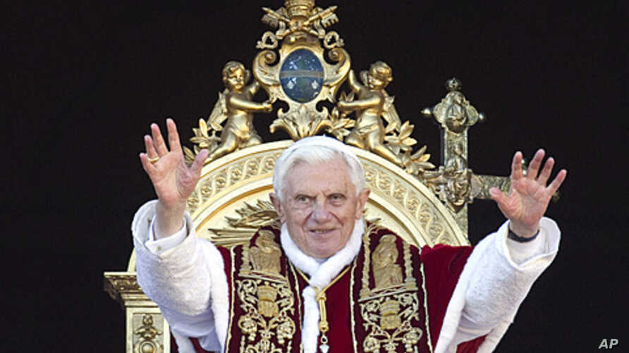 """Pope Benedict XVI delivers his """"Urbi et Orbi"""" (to the City and to the World) speech from the central loggia of St. Peter's Basilica at the Vatican, December 25, 2011."""