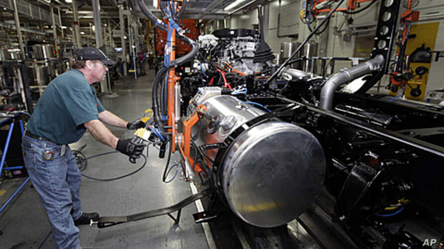Thomas Warren installs a fuel cell on a Freightliner truck at a plant in Cleveland, NC, January 12, 2012.