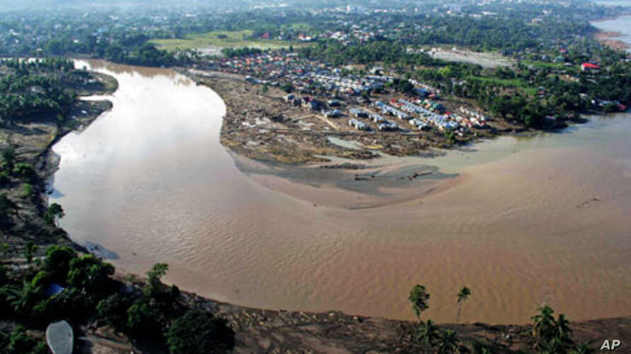 An aerial view shows damage caused by floods following Typhoon Washi in Iligan City, in the southern island of Mindanao, Philippines, December 19, 2011.