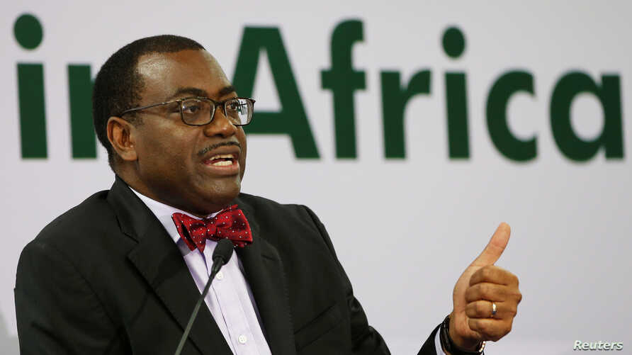 FILE - African Development Bank (AfDB) President Akinwumi Adesina gestures as he addresses a news conference at the annual meeting of AfDB in Gandhinagar, India, May 22, 2017.