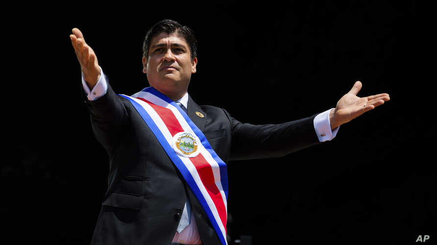 Costa Rica's President Carlos Alvarado greets the public wearing the presidential sash during his swearing-in ceremony, in San Jose, Costa Rica, May 8, 2018.