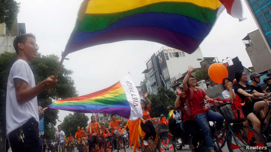 "Participants attend the 5th annual LGBT (Lesbian, Gay, Bisexual  and Transgender) pride parade entitled ""Viet Pride - Path of Pride"" in Hanoi, Vietnam"
