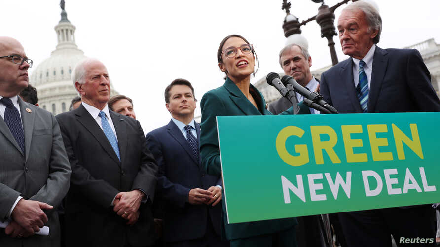 FILE - U.S. Representative Alexandria Ocasio-Cortez (D-NY) and Senator Ed Markey (D-MA) hold a news conference for their proposed Green New Deal to achieve net-zero greenhouse gas emissions in 10 years, at the U.S. Capitol in Washington, Feb. 7, 2019...