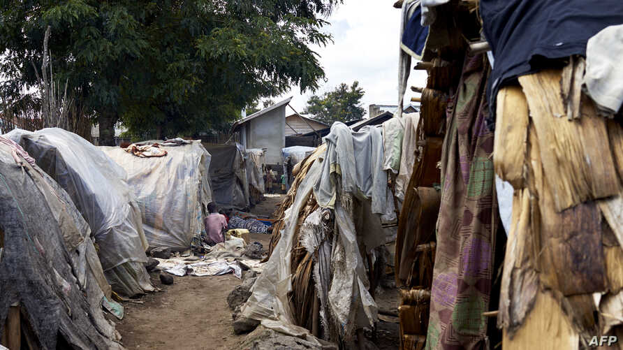 FILE - A view of a refugee camp situated in between a school and a catholic church in Kiwanja, Rutshuru town, North Kivu on May 4, 2018.