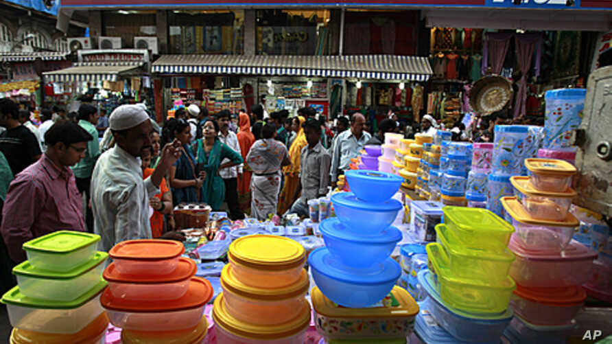 In this Nov. 26, 2011 photo, Indians shop at a crowded market in Mumbai, India. The arrival of modern retailing would hasten a cultural transformation in the way Indians shop and work.
