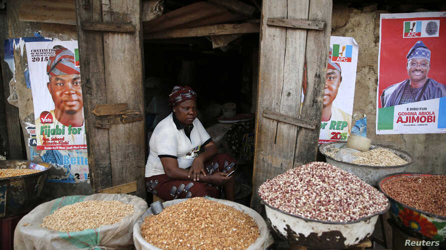 Latefat Alao, 56, a ethnic Yoruba Muslim woman, waits for customers in front of her in Beere market in Ibadan, southwest Nigeria, Jan. 29, 2015.