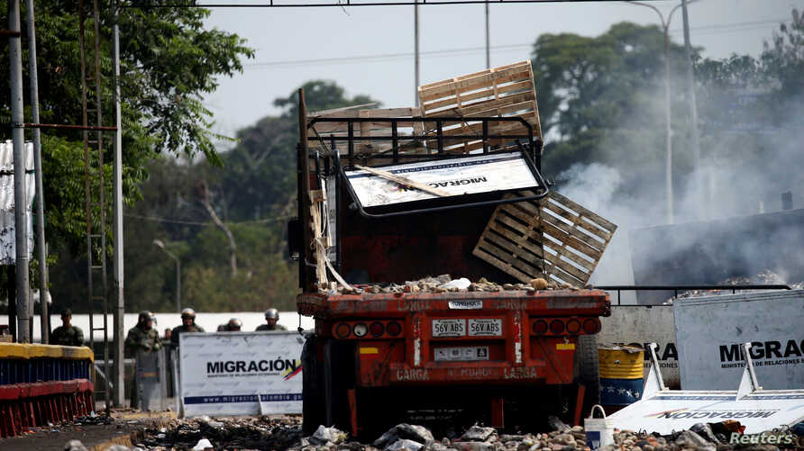 A burnt truck, that was used to transport humanitarian aid, is seen on the Francisco de Paula Santander cross-border bridge between Colombia and Venezuela, after clashes with opposition supporters and Venezuela's security forces, in Cucuta, Colombia