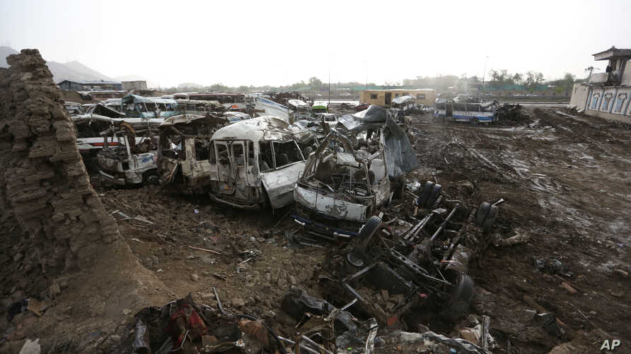 Destroyed cars are seen on the ground after yesterday's Taliban-claimed deadly suicide attack in Kabul, Afghanistan, April 20, 2016.