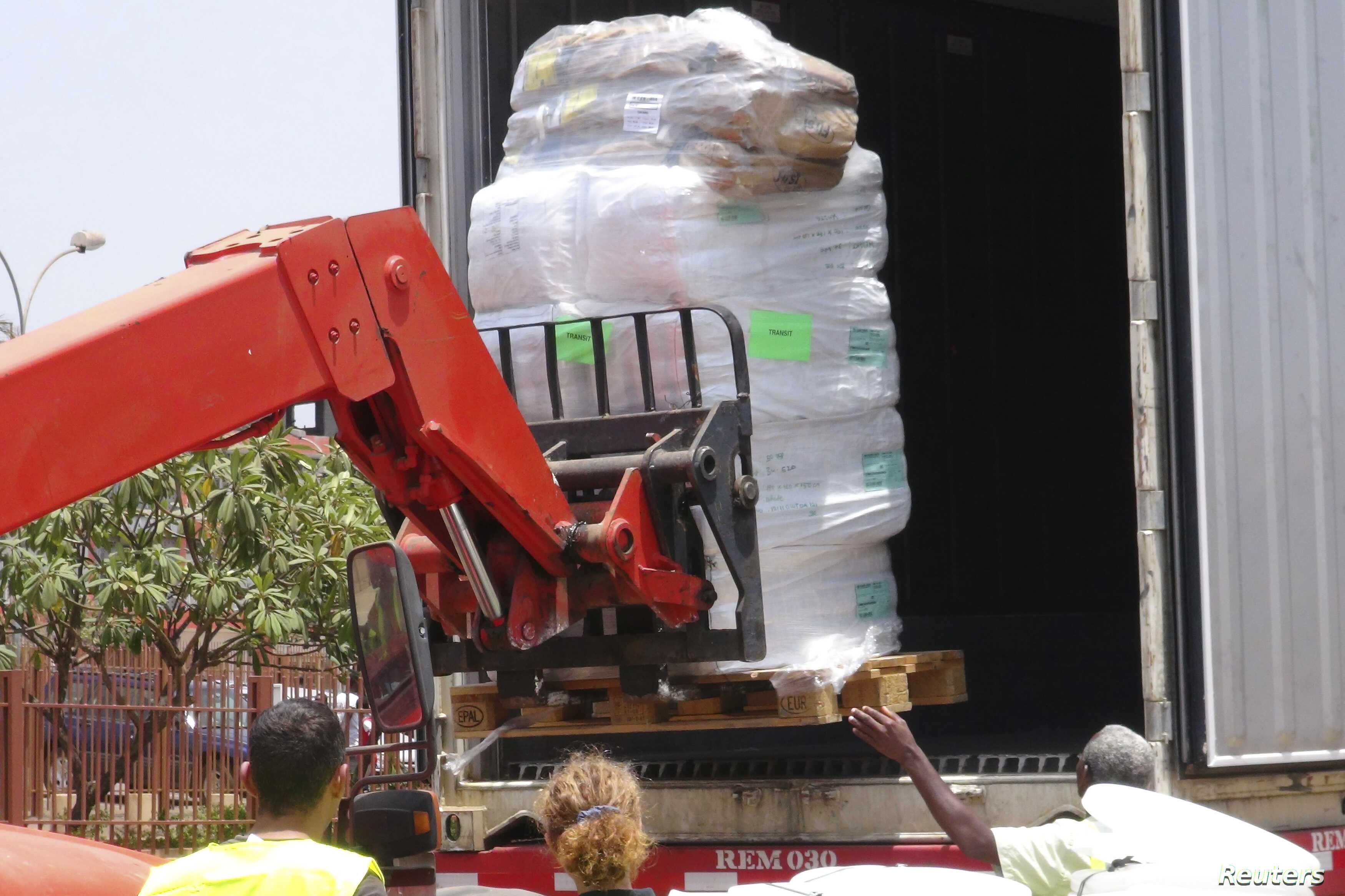 Workers from Doctors Without Borders unload emergency medical supplies to deal with an Ebola outbreak in Conakry, Guinea, March 23, 2014.
